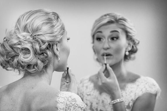Wedding of Caitlin & Ben at The Villa - bride applying makeup