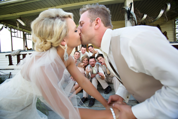 KimAnne Photography - iowa backyard wedding - bride-groom-kiss-bridal-party