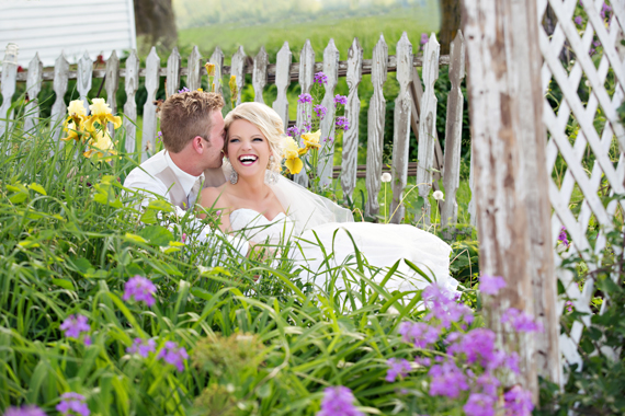 KimAnne Photography - iowa backyard wedding - bride-laughes-with-groom