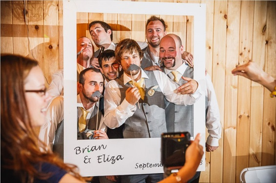 Butler Photography LLC - groomsmen in photobooth