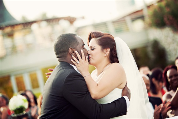 Imagine Studios - bride and groom kiss after saying I do