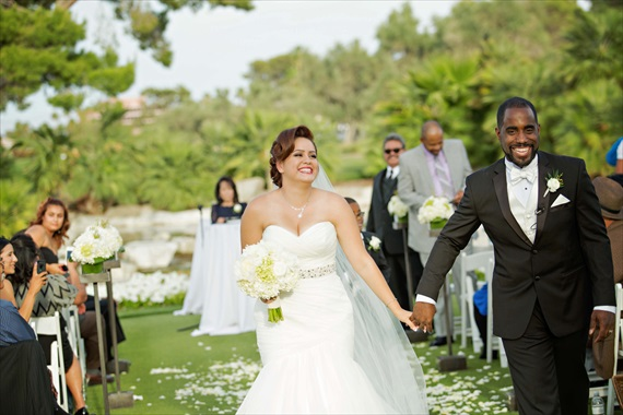 Imagine Studios - bride and groom walk up the aisle at their las vegas wedding