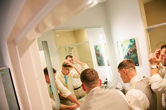 Tate Tullier Photography - Baton Rouge Wedding - groomsmen-looking-in-mirror-getting-ready