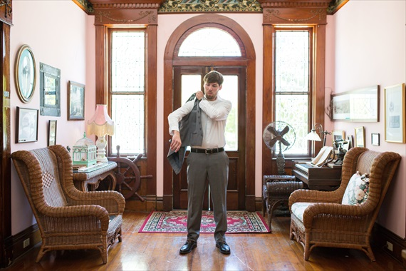 Filda Konec Photography - Hemingway House Wedding - groom gets ready and puts on suit jacket