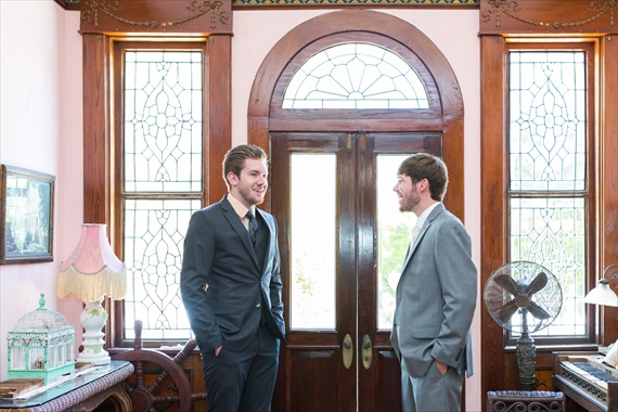 Filda Konec Photography - Hemingway House Wedding - groom talks with best man
