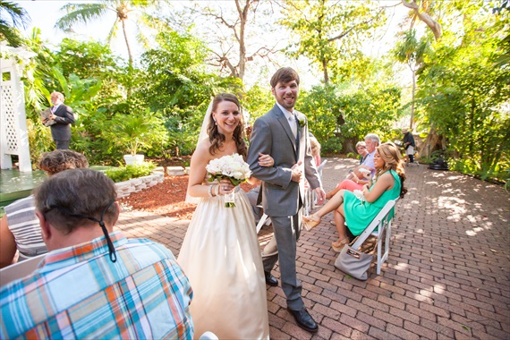 Filda Konec Photography - bride and groom walk up aisle married at hemingway house