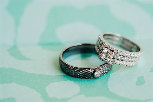 the bride and groom's wedding rings on a tiffany blue background