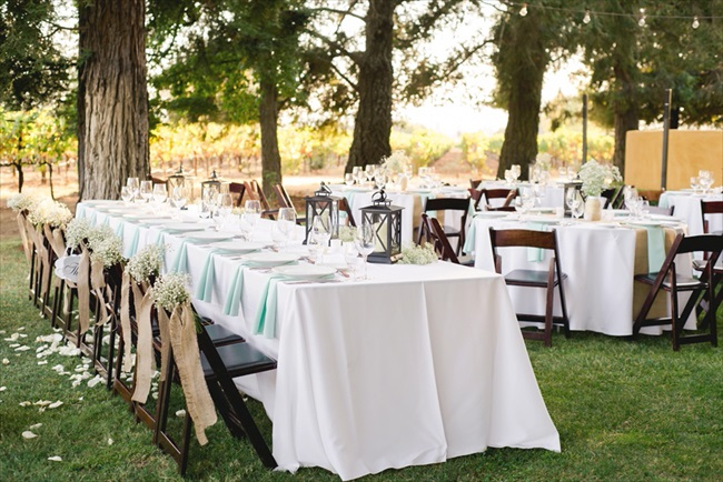 the reception had beautiful round tables with a rectangular head table