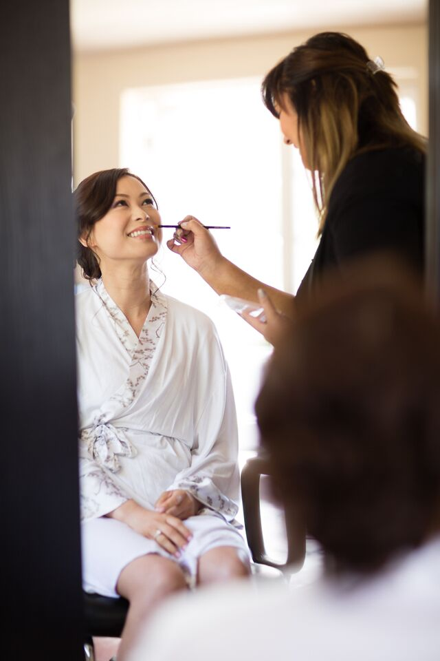 Winery Styled Wedding Shoot - The Bride in Robe Getting Makeup Done