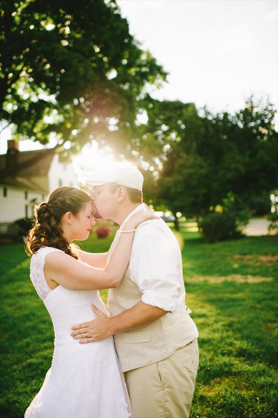 americana-wedding-bride-kissing-grooms-forehead (photo: michelle gardella)