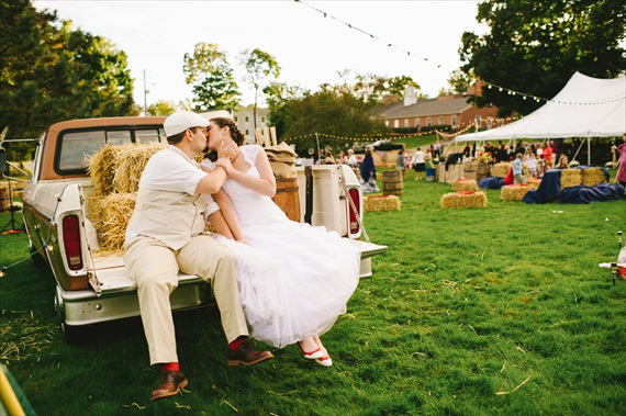 americana-wedding-rustic-pickup-truck-hay-bales-bride-groom-kissing (photo: michelle gardella)