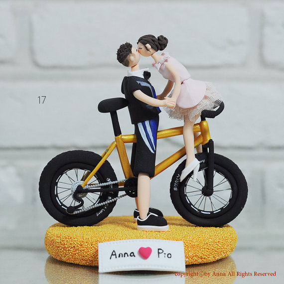 bicycle themed wedding - custom couple cake topper on bicycle