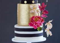 black and white striped gold metallic wedding cake