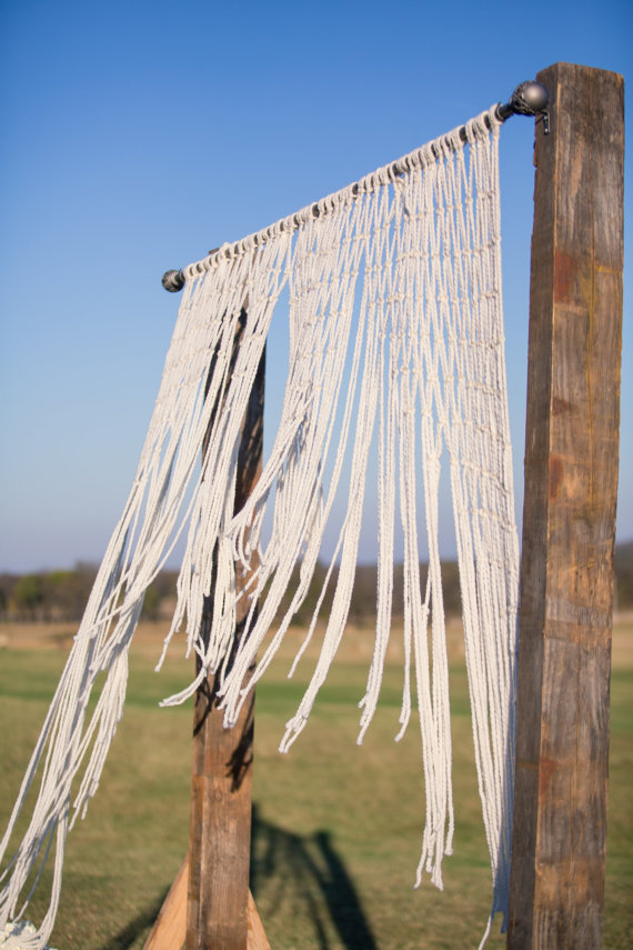 Use this bohemian inspired macrame backdrop for your ceremony. By The House Phoenix. | etsy boho weddings | http://emmalinebride.com/bohemian/etsy-boho-weddings/