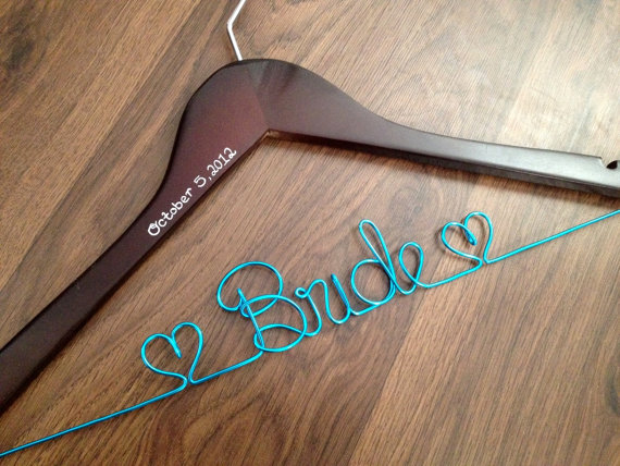bride dress hanger | via 10 NEW Something Blue Ideas | http://emmalinebride.com/bride/new-something-blue/