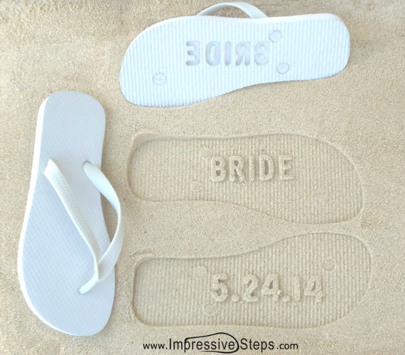 These flip flops are customized with your wedding date.  When you walk on the shore, your date will be imprinted into the sand. Cute! | via 31 Best Handmade Wedding Shoes http://emmalinebride.com/bride/handmade-wedding-shoes/