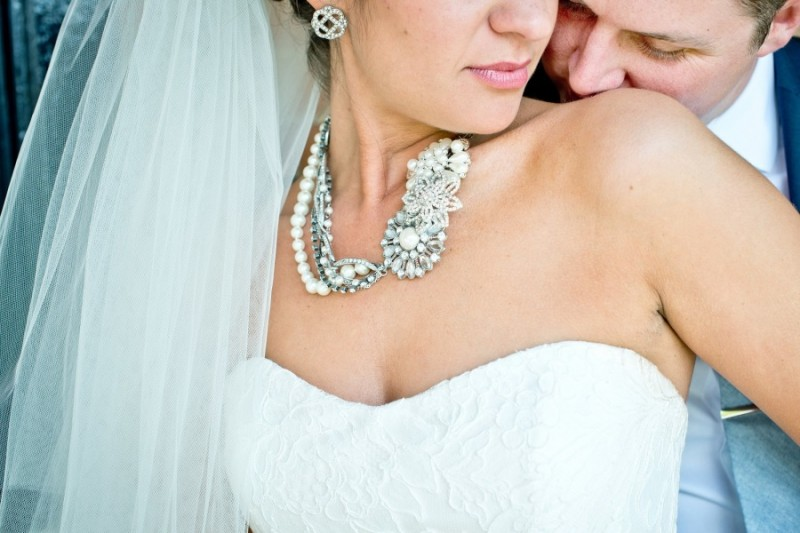 bride with statement necklace strapless gown