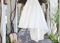 bride's dress on custom hanger - photo by Shillawna Ruffner Photography