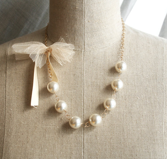 Cream and Gold Wedding Ideas: bridesmaid necklace with tulle bow (by Laura Stark)