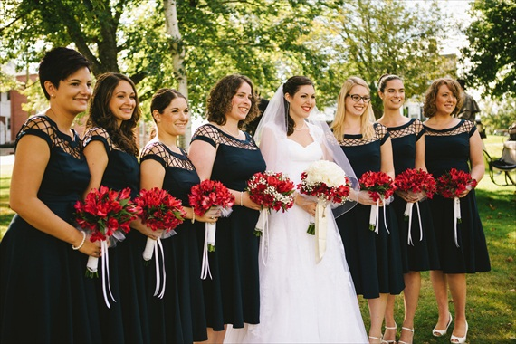 bridesmaids-black-dresses-red-bouquets (photo: michelle gardella)