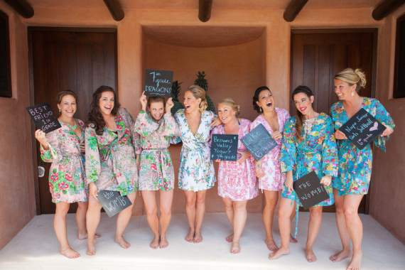 diy bridesmaids with chalkboards describing how they met the bride