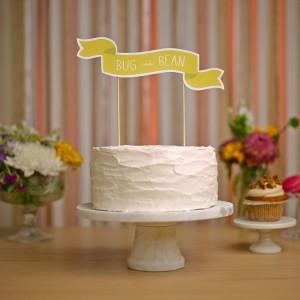 bug and bean yellow wedding banner cake topper