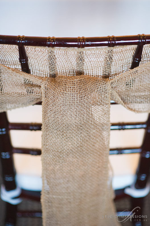 burlap chair sashes | 50 Best Burlap Wedding Ideas | via http://emmalinebride.com/decor/burlap-wedding-ideas/