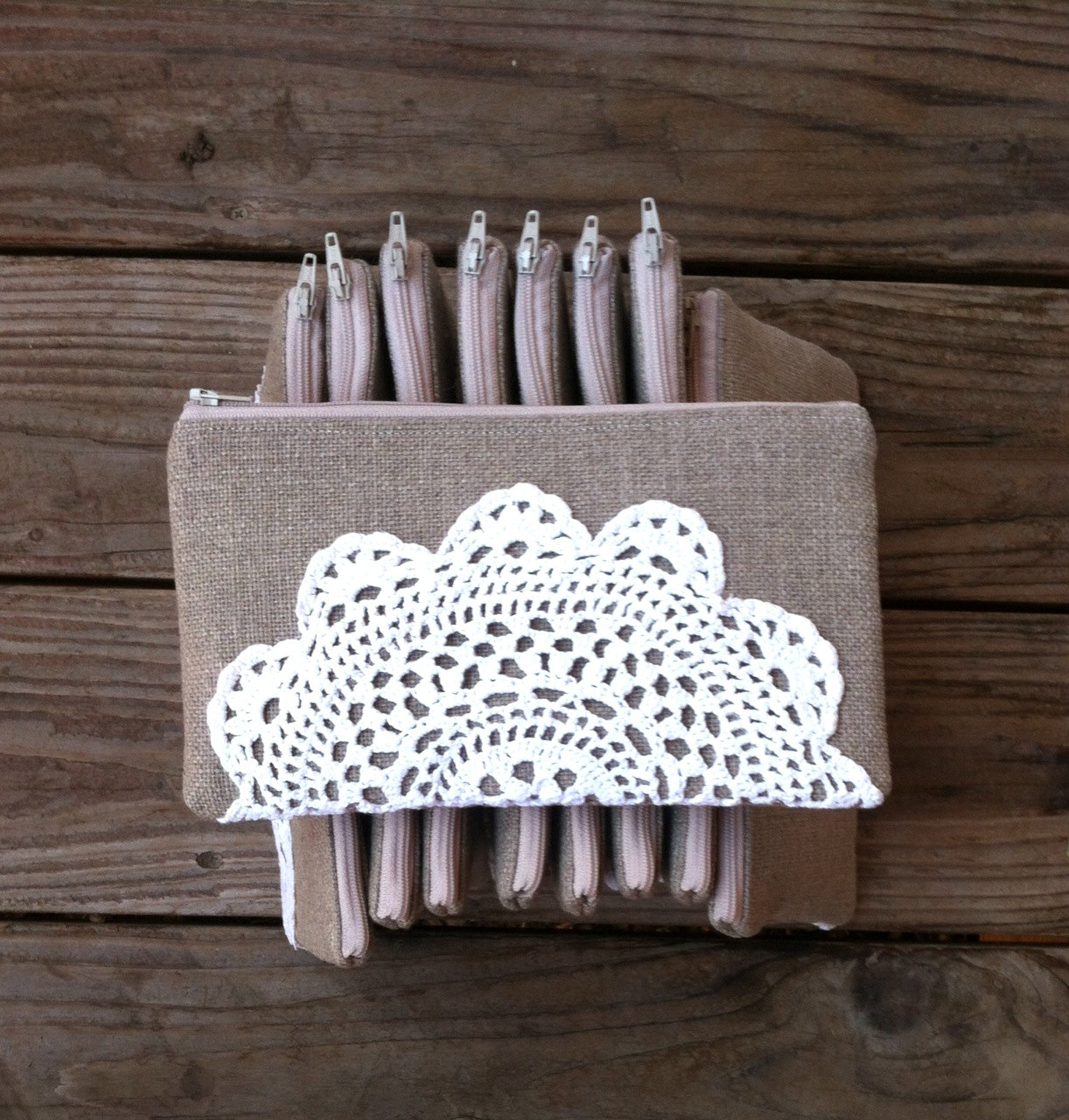 burlap clutch with doily | 50 Best Burlap Wedding Ideas | via http://emmalinebride.com/decor/burlap-wedding-ideas/