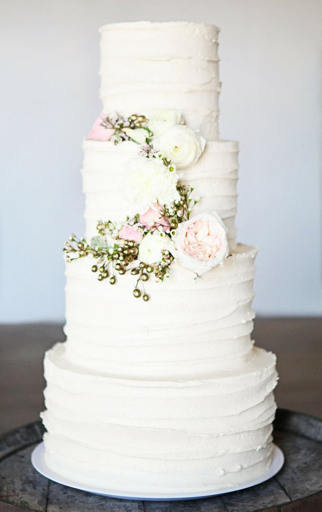 buttercream wedding cake ivory and pink flowers