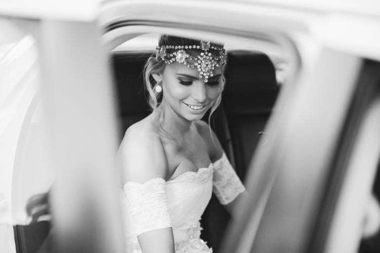 bw of bride in car with crystal headpiece