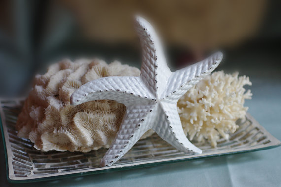 10 Beach Wedding Centerpieces via EmmalineBride.com - cast iron starfish by By The Seashore