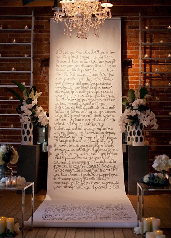 chandelier above ceremony space with handwritten scroll
