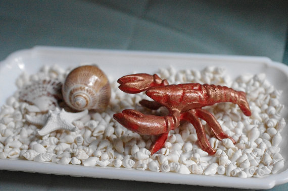 10 Beach Wedding Centerpieces via EmmalineBride.com - crawfish paperweight cast iron by By The Seashore