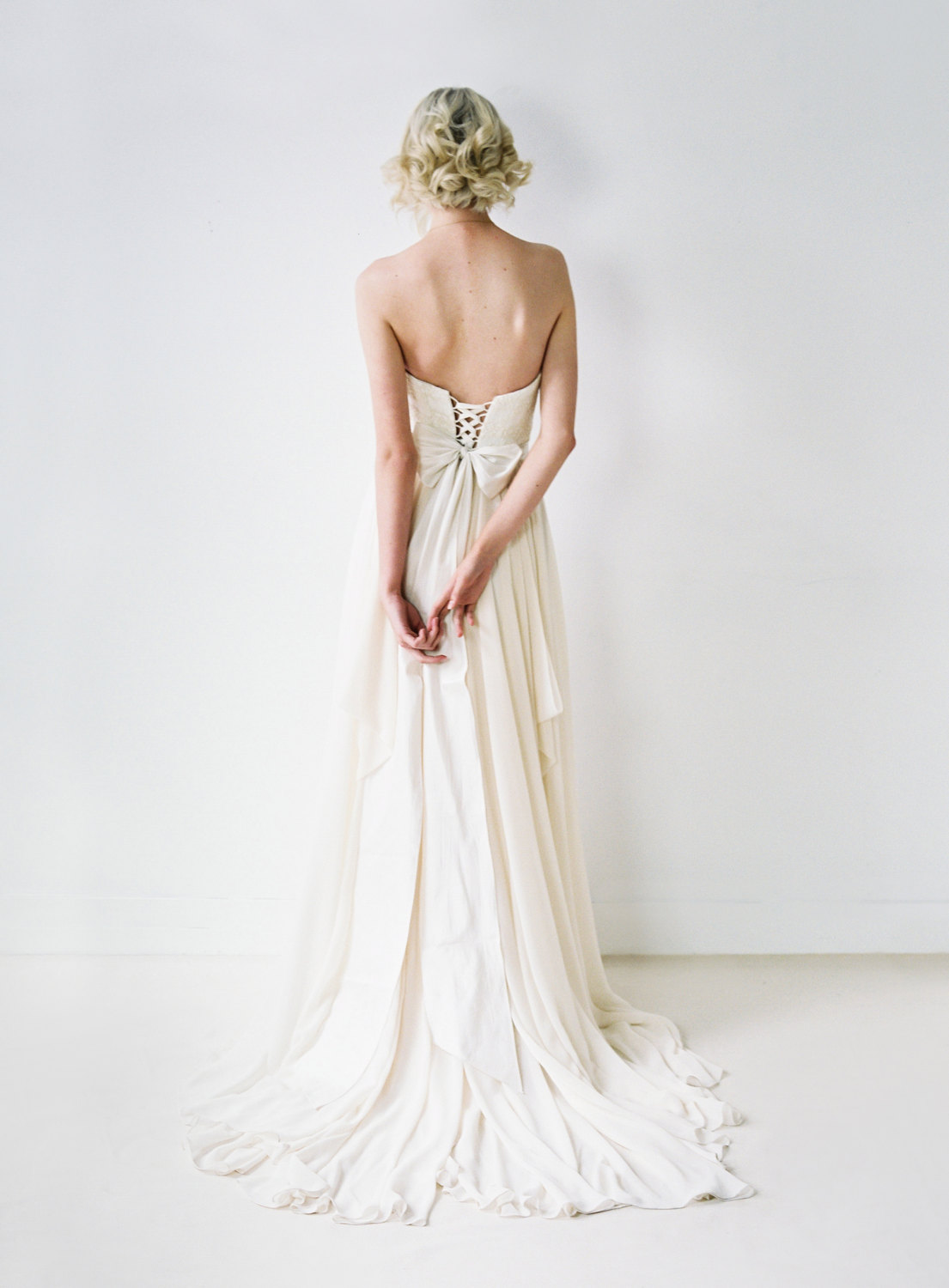cross back chiffon gown with bow