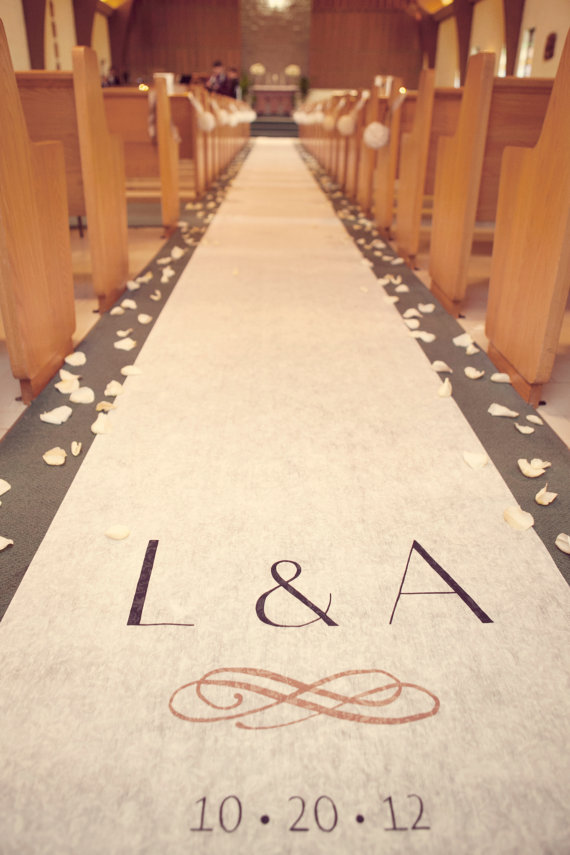 An aisle runner can be an unexpected place for personalizing:  add your wedding initials for a handcrafted touch.