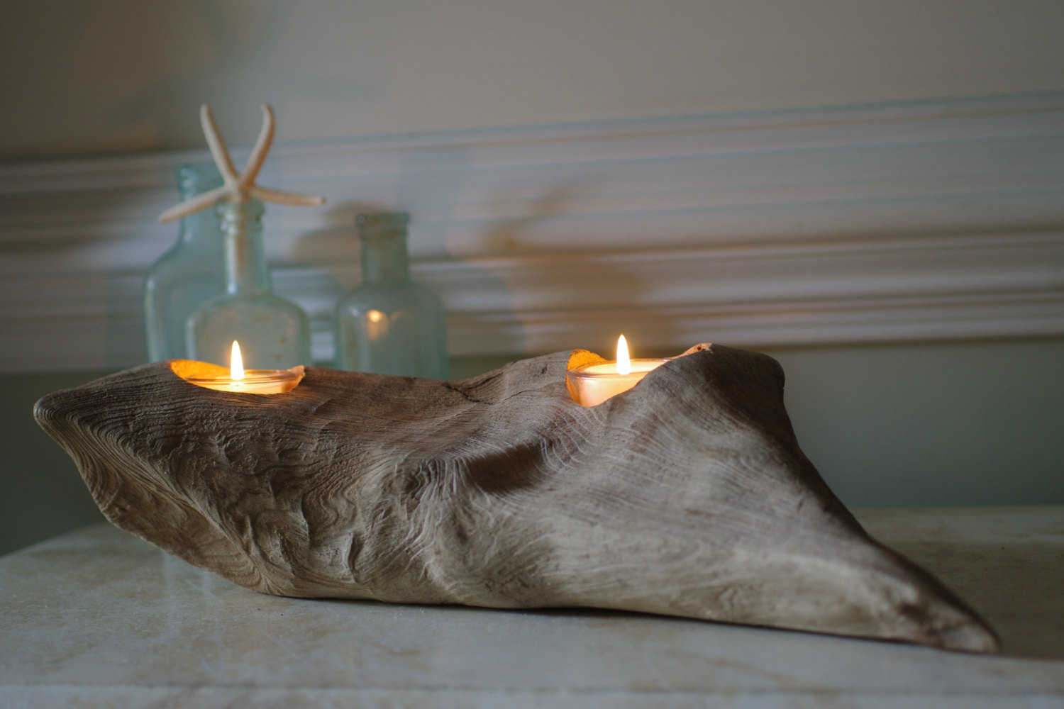 decorate for beach wedding reception with driftwood candle holders.  from by the seashore decor via emmalinebride.com