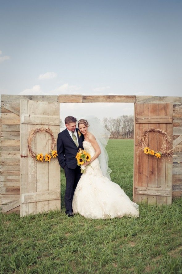 fall wedding backdrop with doors | Ceremony Backdrops Doors | photo: Laura Leigh Photo