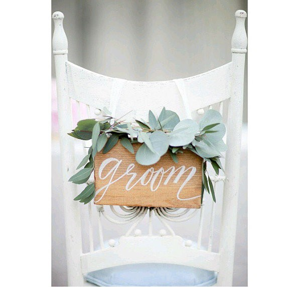 groom chair sign | via http://emmalinebride.com/decor/bride-and-groom-chairs/