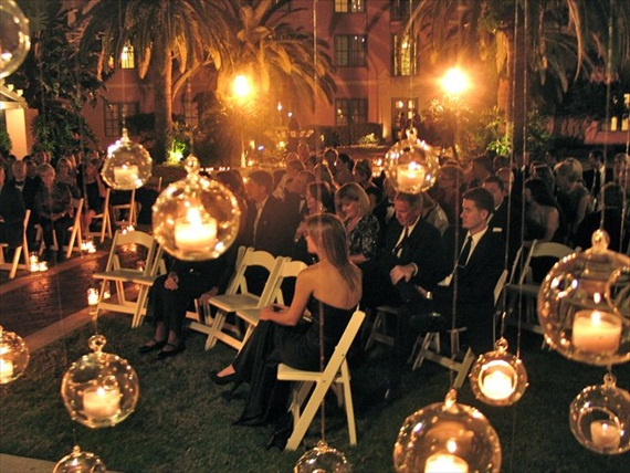 night wedding ideas: hanging glass orbs with battery operated candles inside