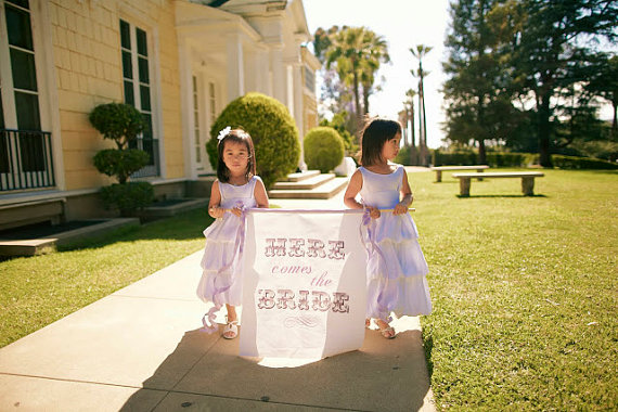 Here Comes the Bride Banner (by Fabulously Wed, photo by Desi Baytan) - What Does a Flower Girl Do? via EmmalineBride.com