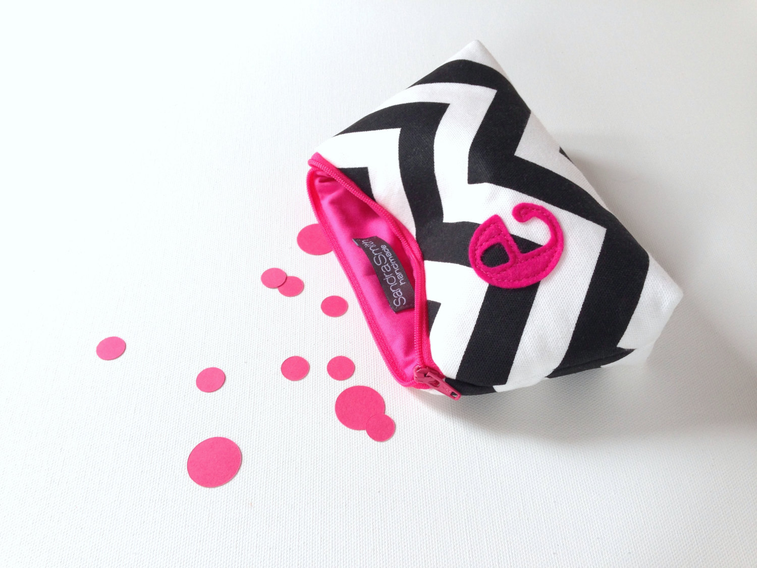 hot pink and black cosmetic bag by sandra smith handmade | fun bachelorette party ideas | https://emmalinebride.com/planning/fun-bachelorette-party-ideas/