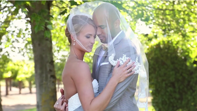 bride and groom under veil in their wine country wedding video