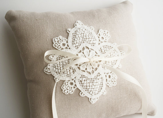 lace ring pillow chambery via 8 Chic Linen Ring Pillows