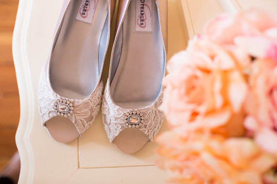 Custom handmade wedding shoes with lace and decorative rhinestone detail. By Becca and Louise.