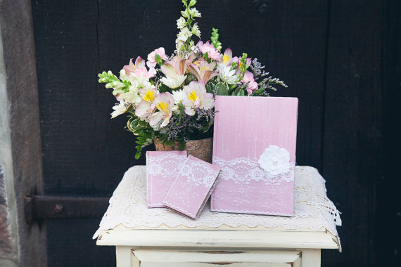 8 Fresh Rustic Wedding Decor Ideas - lace wrapped vow books (by PNZ Designs, photo: Melania Marta Photography)