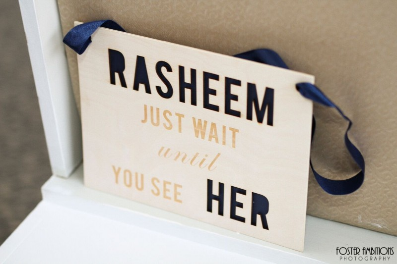 mansion on main street wedding - Flower girl carrying sign that reads, 'Rasheem, just wait until you see her'. Cute!