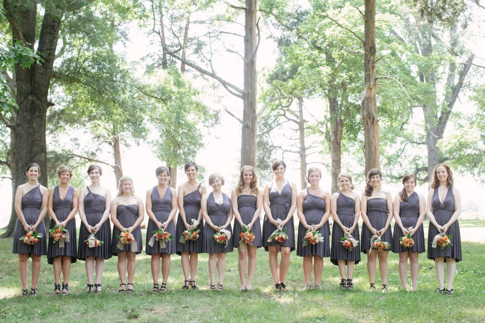 many bridesmaid dresses in charcoal grey infinity style via http://emmalinebride.com/bridesmaids/bridesmaid-dress-worn-different-ways/