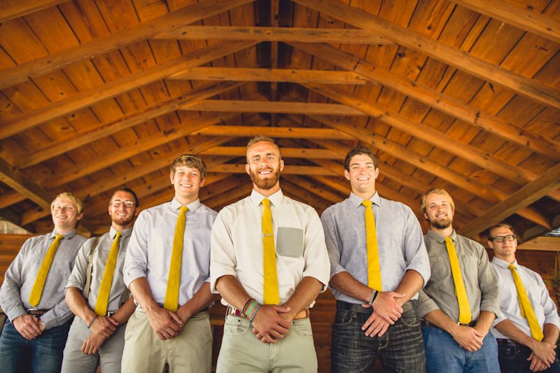 These groomsmen ties are perfectly coordinated to the bridesmaids skirts.  Love the mustard yellow color! | http://emmalinebride.com/bridesmaids/bridesmaid-skirts-hi-low-hem/