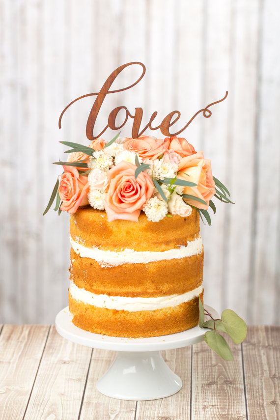 Naked wedding cakes look great as-is, or add a unique topper to add a personalized touch.  This wood cake topper by Better Off Wed Rustics is one of our favorite looks.