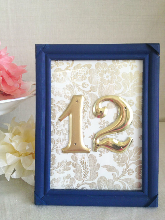 Gold Table Numbers with Navy Blue Frame (by River Kiss Weddings via Emmaline Bride)